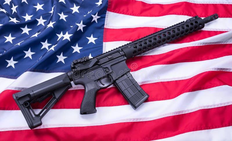 Custom built AR-15 carbine on American flag surface, background. Studio shot. stock images