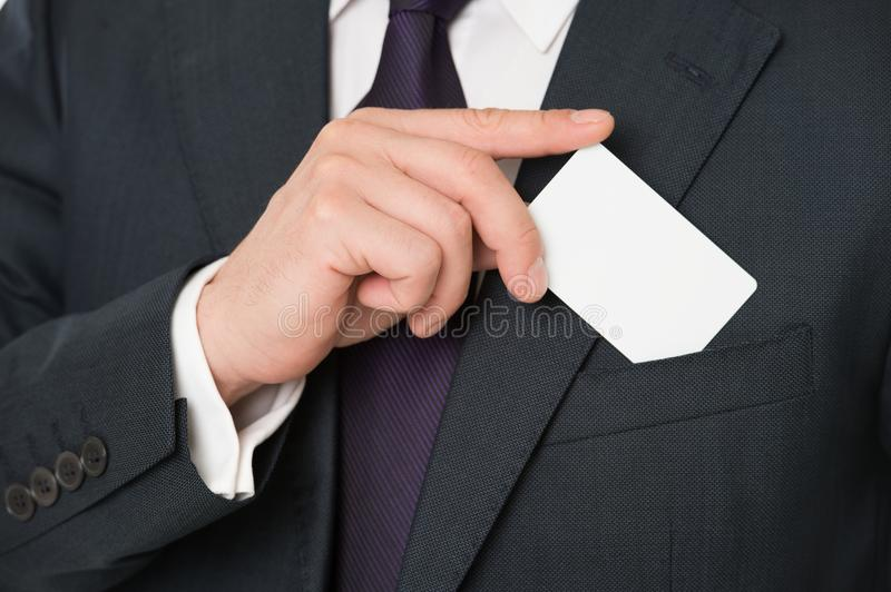 Custom debit card design. Male hand put plastic blank white card to pocket classic suit jacket. Business man carries stock images