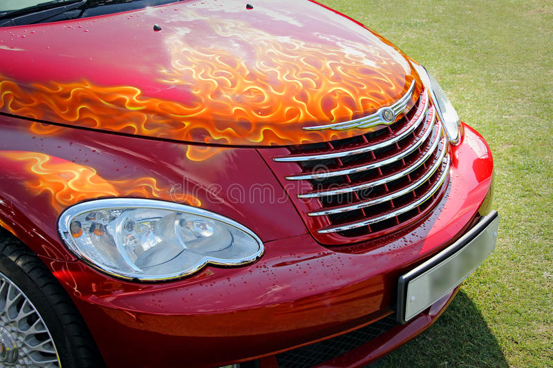 Custom flames on car bonnet. Photo of custom flames painted onto a customised chrysler car at show royalty free stock image