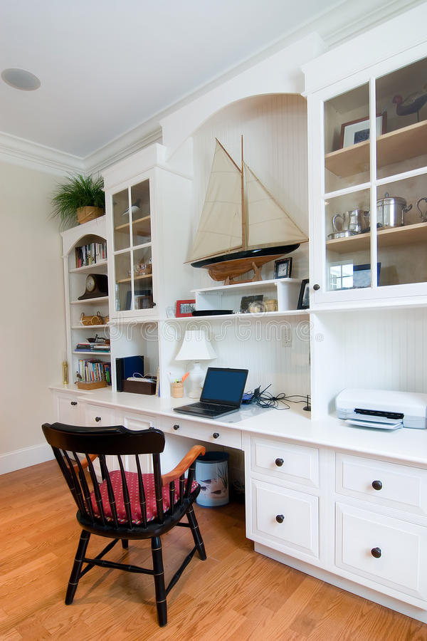 Custom home office. With built in cabinets stock photography