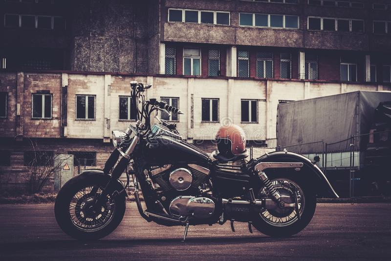 Custom made bobber motorcycle. On a road stock photos