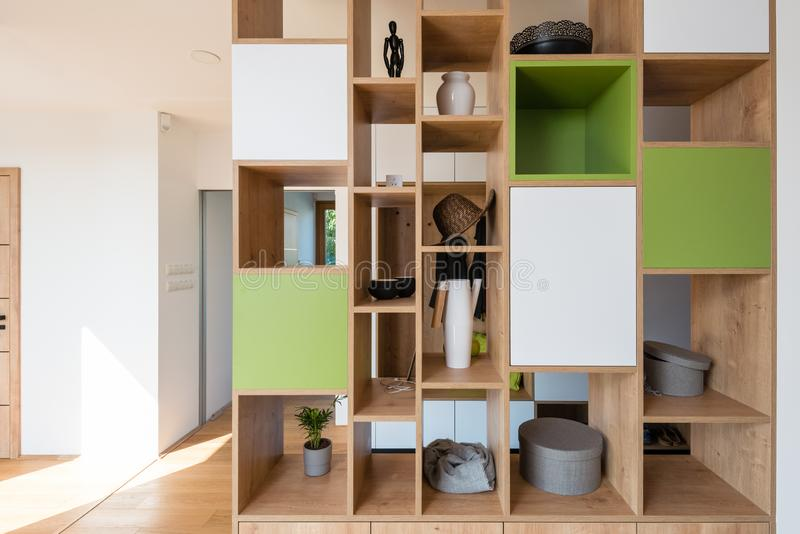 Colorful wooden shelves in the hall of modern house stock photos