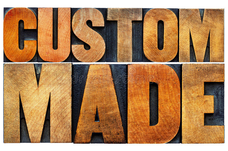 Custom made word abstract typography. Custom made word abstract - isolated text in vintage letterpress wood type printing blocks royalty free stock image