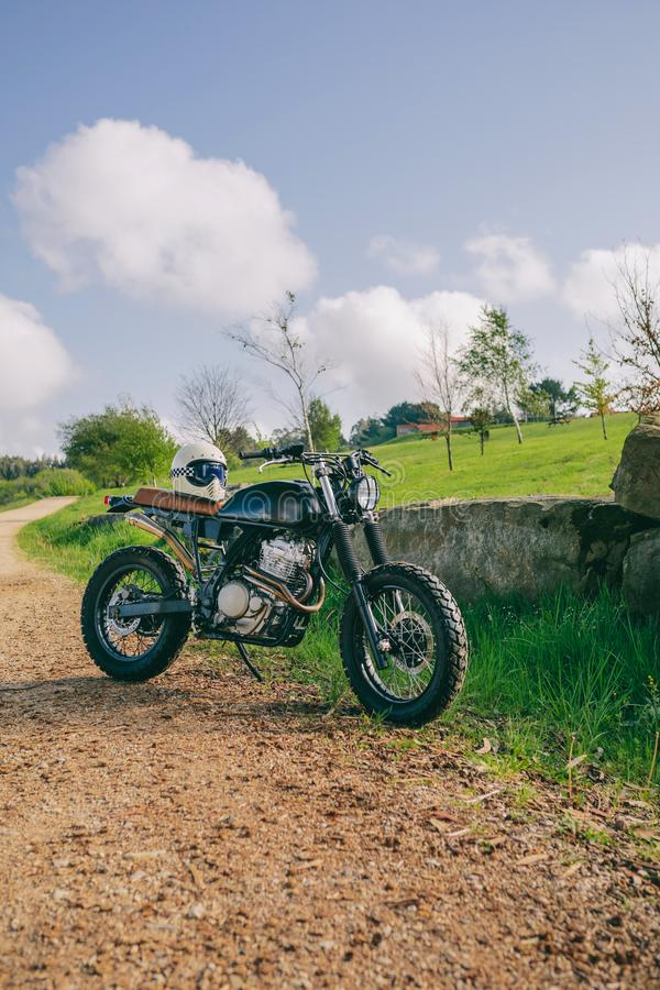 Custom motorcycle parked on the road. Beautiful vintage custom motorcycle parked on the side of the road stock image