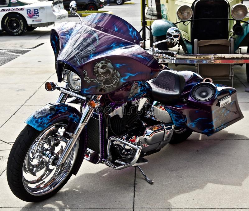 Custom motorcycle with skulls. And a spaker system. Purple and blue paint stock image