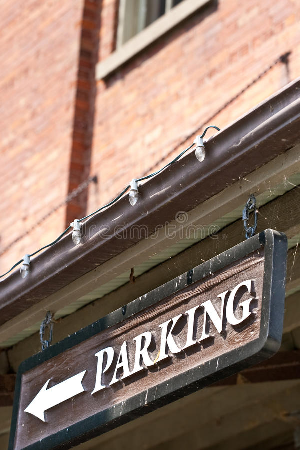Custom Parking Sign With Arrow On Side Of Building Stock