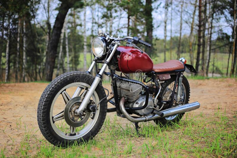 Custom retro motorcycle. Red color outdoors royalty free stock photography