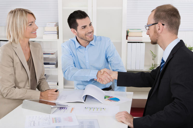 Customer appointment: business team with client making handshake. Customer appointment: business people with client making handshake royalty free stock images
