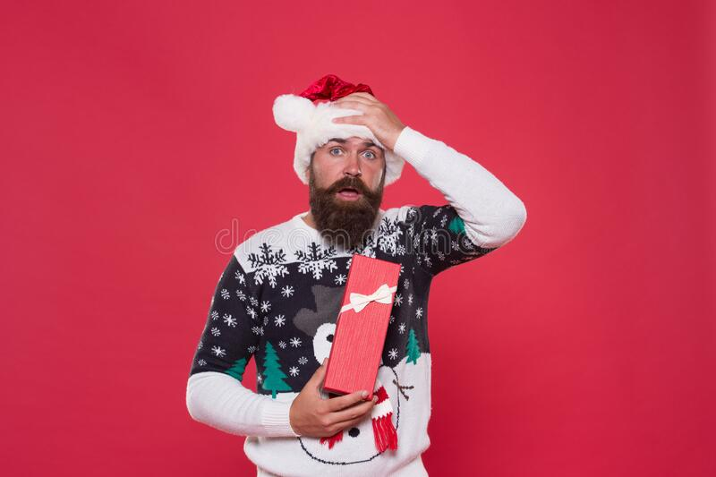 Customer appreciation discount day. winter vacation time. merry christmas to you. surprised man present box. hipster royalty free stock photo