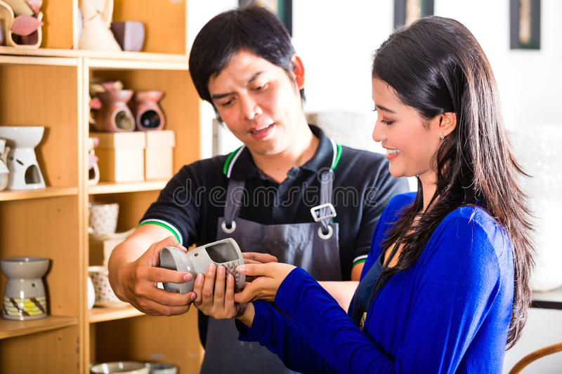 Customer in an Asian Pottery shop royalty free stock photos
