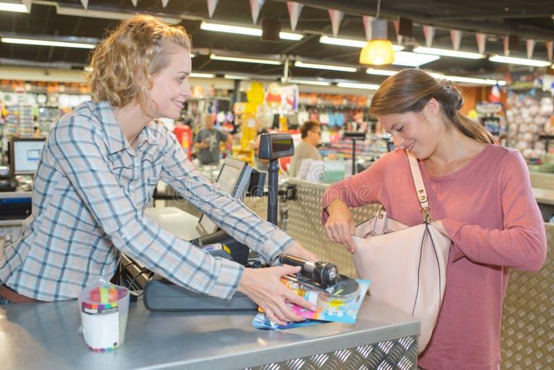 Customer buying food at supermarket and making check out royalty free stock photo