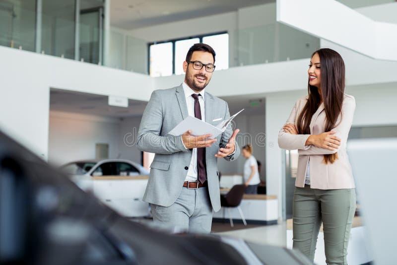 Customer buying a vehicle at new car dealership royalty free stock photos