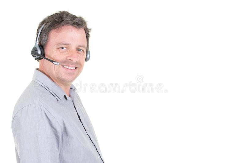 Customer call center man service representative talking on phone with headset phone royalty free stock photos