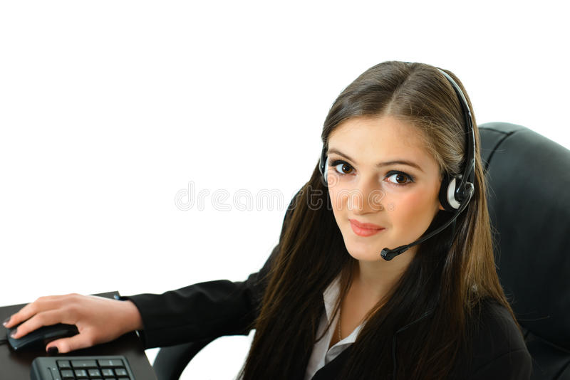 Customer Care Rep on Computer. Customer care representative working at her station looking up royalty free stock photography