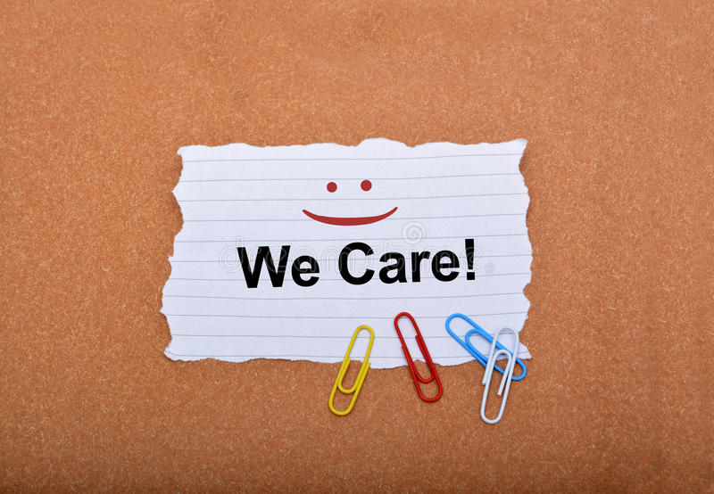 Customer Care sign with smile on paper.  royalty free stock images