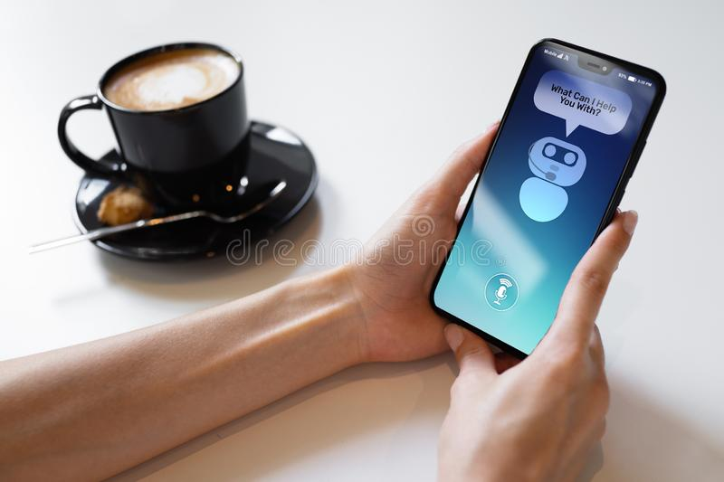Customer and chatbot dialog on smartphone screen. AI. Artificial intelligence and service automation technology concept. Customer and chatbot dialog on stock image