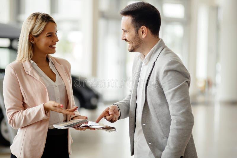 Customer choosing color at dealership royalty free stock photo