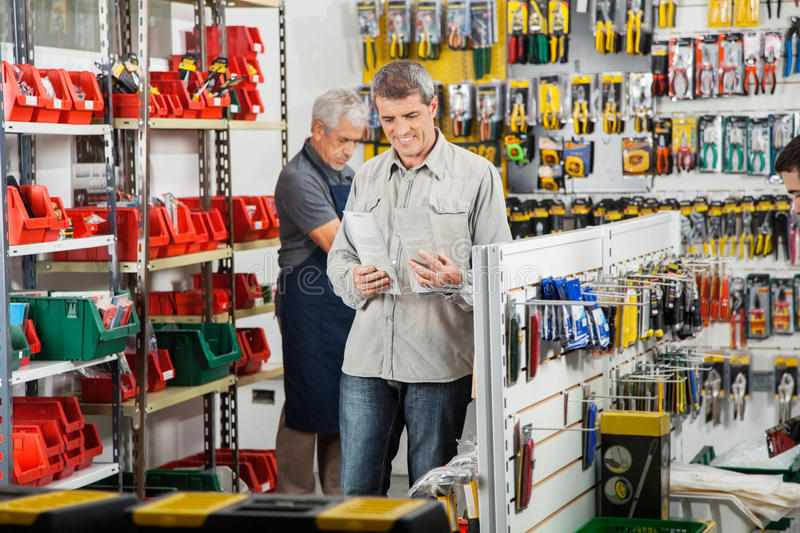 Customer Choosing Soldering Iron In Store royalty free stock images