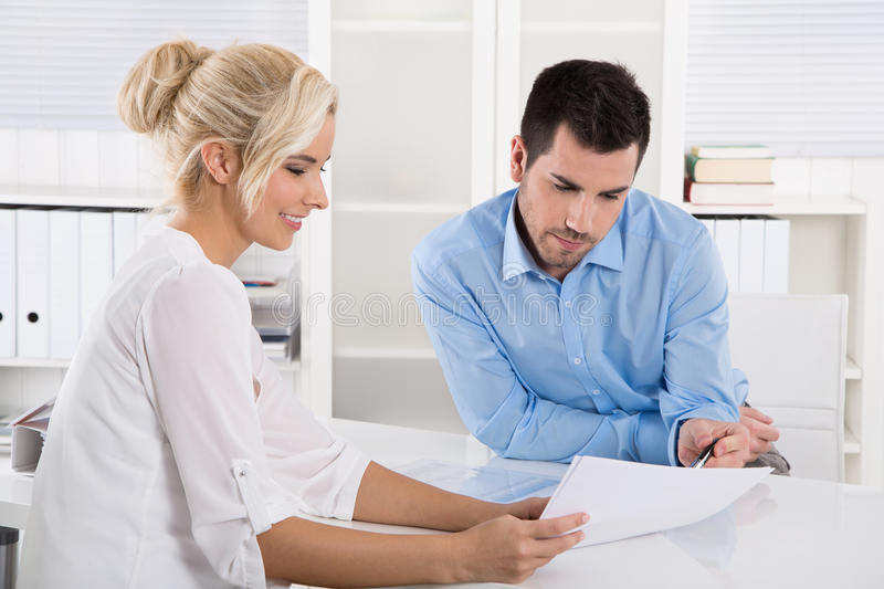 Customer and client sitting at desk or business people talking a royalty free stock image