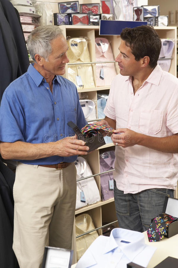 Download Customer In Clothing Store With Sales Assistant Stock Image - Image: 10971869