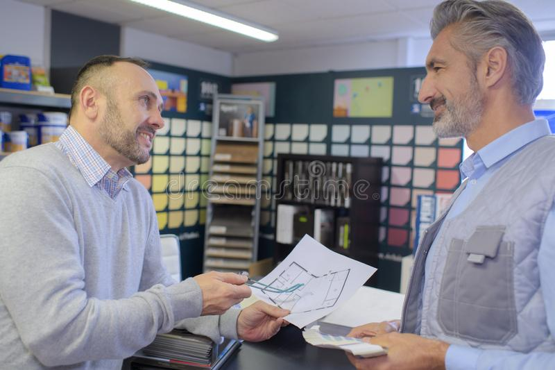 Customer and designer discussing project in agency royalty free stock photography