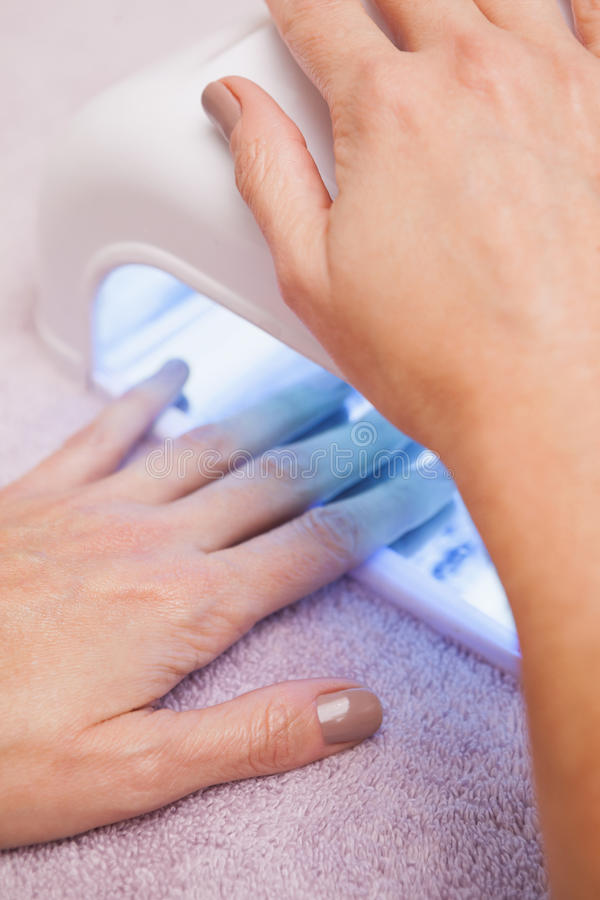 Customer drying their painted nails stock photos
