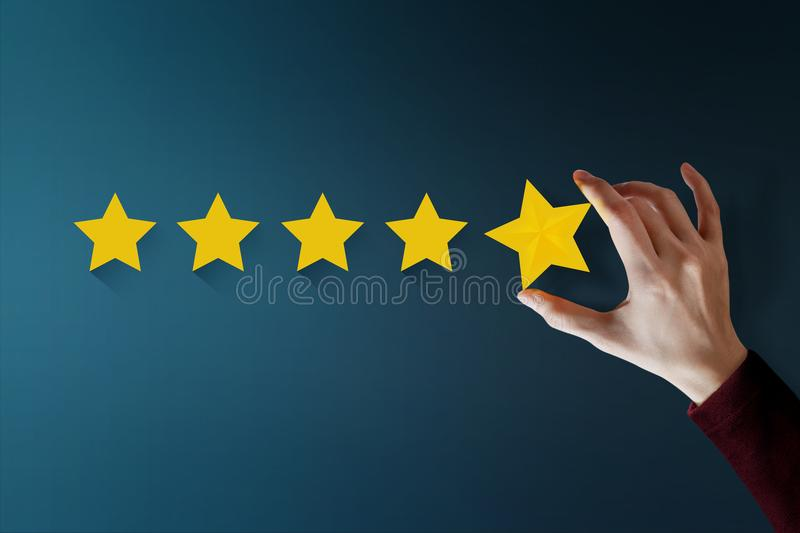 Customer Experience Concept, Best Excellent Services for Satisfaction present by Hand of Client giving a Five Star Rating royalty free stock photo