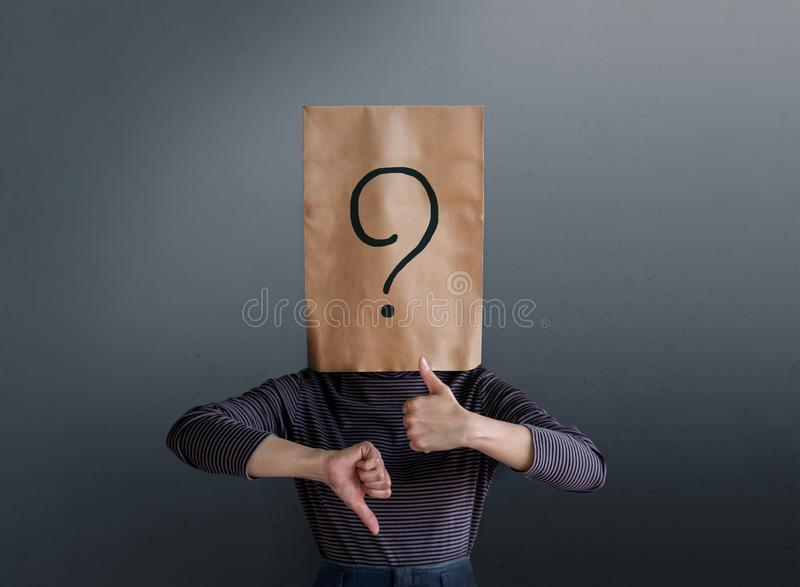 Customer Experience Concept. Client Woman with Question Mark Icon on Paper Bag has Confused to Feedback Review Between Positive. And Negative stock image
