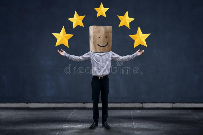 Customer Experience Concept, Happy Businessman Client with Smiling Face Emotion on Paper Bag, Raising Hands to Giving Five Star R stock photos