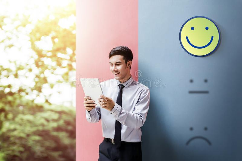Customer Experience Concept, Happy Businessman Enjoying on digit. Al Tablet with Smiley Face Rating for a Satisfaction Survey stock photos