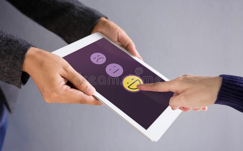Customer Experience Concept. Happy Client Pressing a Smiley Face stock images