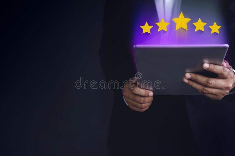 Customer Experience Concept. Part of Businessman in Black suit u royalty free stock photo