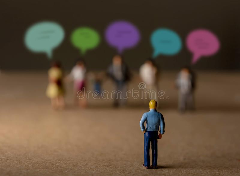 Customer Experience Concept. present by Miniature Figure of Businessman Listening Feedback from Diversity Clients royalty free stock images