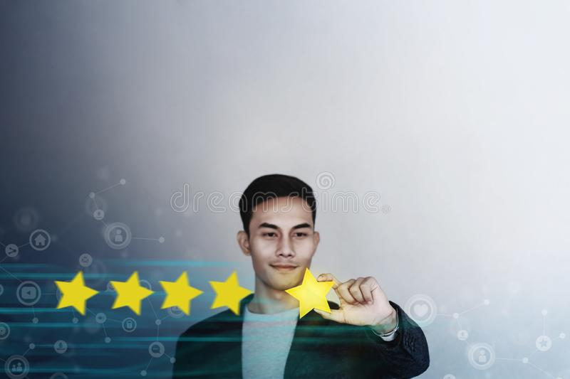 Customer Experience Concept. Young Businessman with Happy Face Showing his Five Star Services Rating Satisfaction. Happy Client`s. Feedback and Online Review royalty free stock image