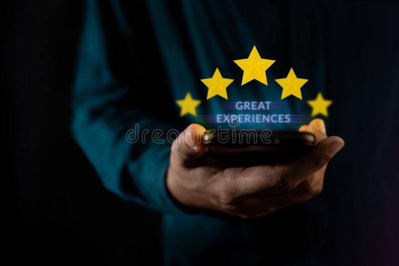 Customer Experiences Concept. a Modern Man Giving Five Stars Rating, Positive Review via Smartphone. Client`s Satisfaction Survey stock photos