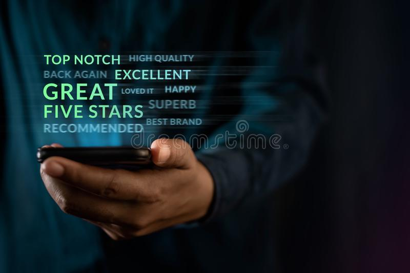 Customer Experiences Concept. Modern Man Reading Positive Review Rating via Smartphone. Client`s Satisfaction Surveys royalty free stock images