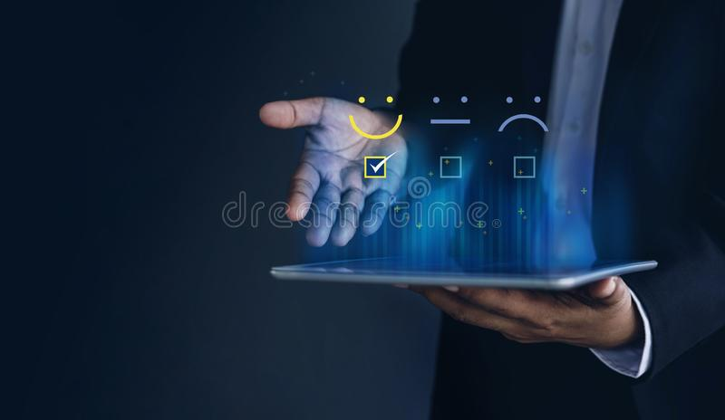 Customer Experiences Concept. Positive Review and Feedback, Businessman in Suit Present Excellent Rating with Smiling icon for a. Satisfaction on digital tablet stock image