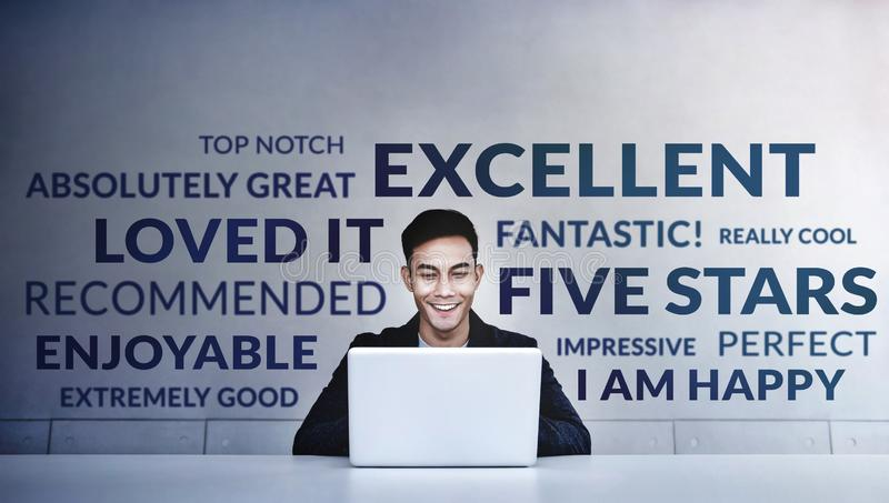 Customer Experiences Concept. a Young Happy Man Reading Positive Review Rating via Computer Laptop. Client`s Satisfaction Survey royalty free stock photography