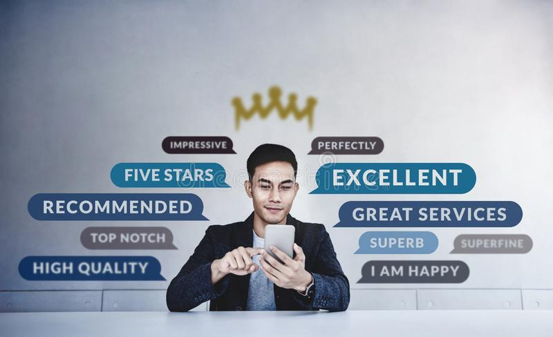 Customer Experiences Concept. a Young Happy Man Reading Positive Review Rating via Smartphone. Client`s Satisfaction Surveys royalty free stock photography