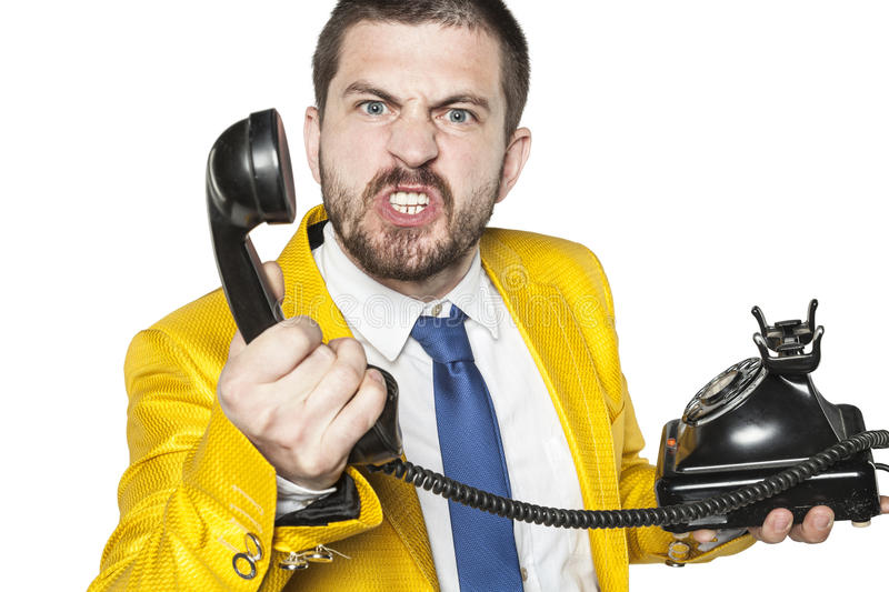 Customer explodes with anger when talking to call center. Business man royalty free stock photos