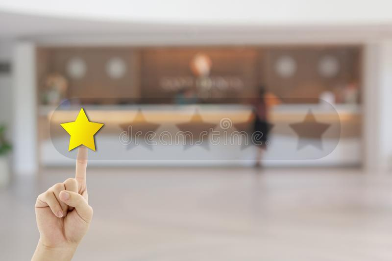Hand pressing one yellow star for giving best service ranking. Customer Feedback Concept : Hand pressing one yellow star for giving best service ranking with stock photography