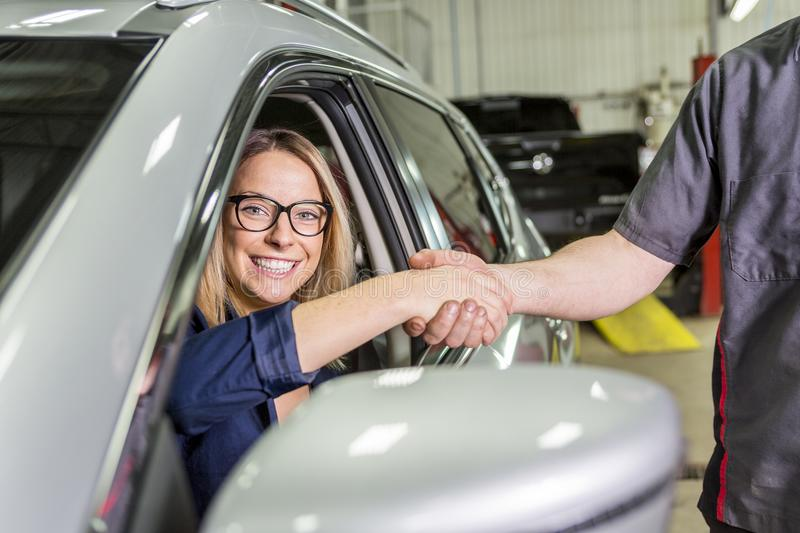Customer in the garage with repair car. A Customer in the garage with repair car stock photography