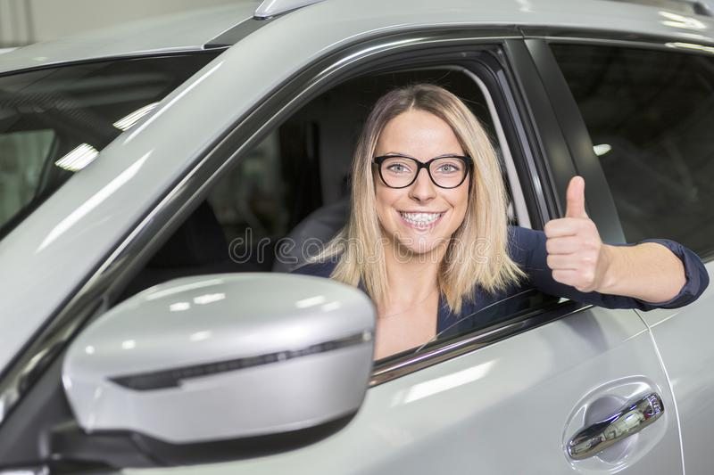 Customer in the garage with repair car. A Customer in the garage with repair car stock photos