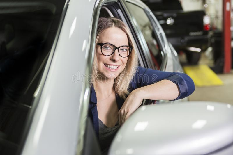 Customer in the garage with repair car. A Customer in the garage with repair car royalty free stock photo
