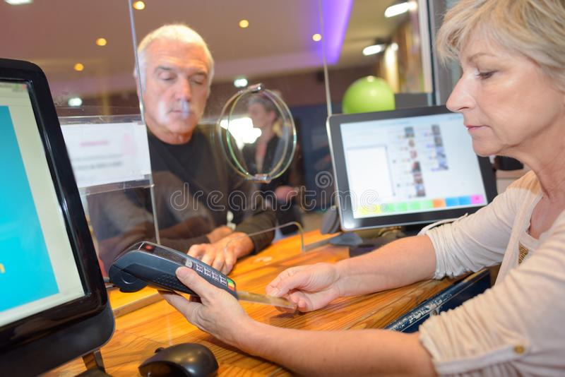 Customer getting cash out from bank cashier. Bank royalty free stock photography