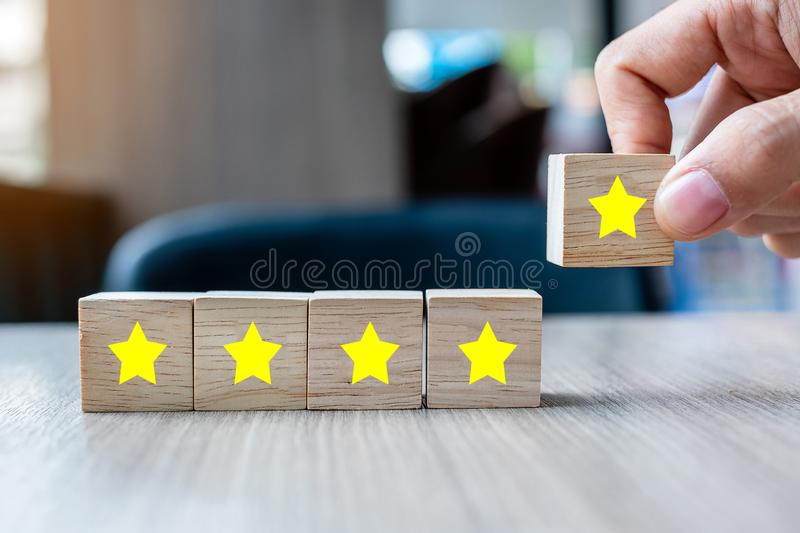 Customer holding wooden blocks with the five star symbol. Customer reviews, feedback, rating, ranking and service concept.  stock photo