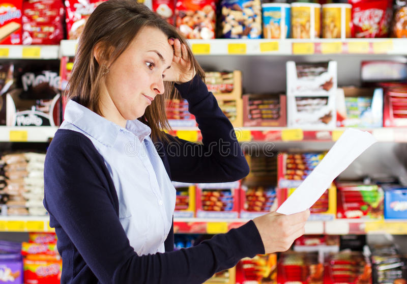 Customer Looking At Shopping List Royalty Free Stock Images