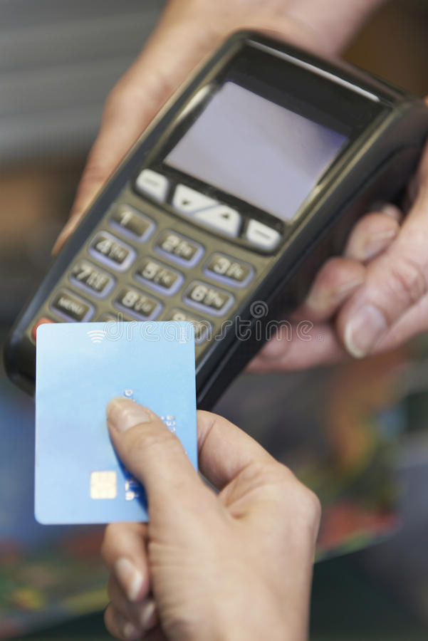 Customer Making Purchase Using Contactless Payment. Close Up Of Customer Making Purchase Using Contactless Payment royalty free stock image