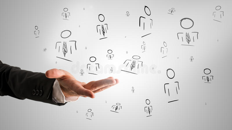 Customer managed relationship concept. With a male hand presenting random people icons royalty free stock photo