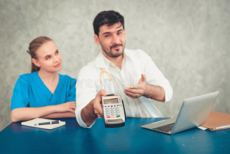 Customer medical service for patient paying bill by credit card, Healthcare business concept stock photos